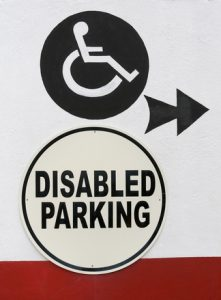 disabled-parking-sign-displaying-a-wheel-chair-1632477-221x300